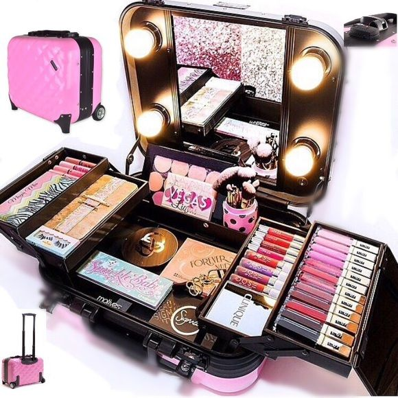 "PRO TRAVEL MAKEUP KIT WITH WHEELS Ñ HANDLE. **NIB Good lighting is so important for glamming and looking pretty. If you travel often or you are a professional MUA, this case is exactly what you need. It's TSA approved professional makeup kit.  Additional Information Dimensions: 16"" * 9"" * 14.5"" Colors: Pink, Black Bags"