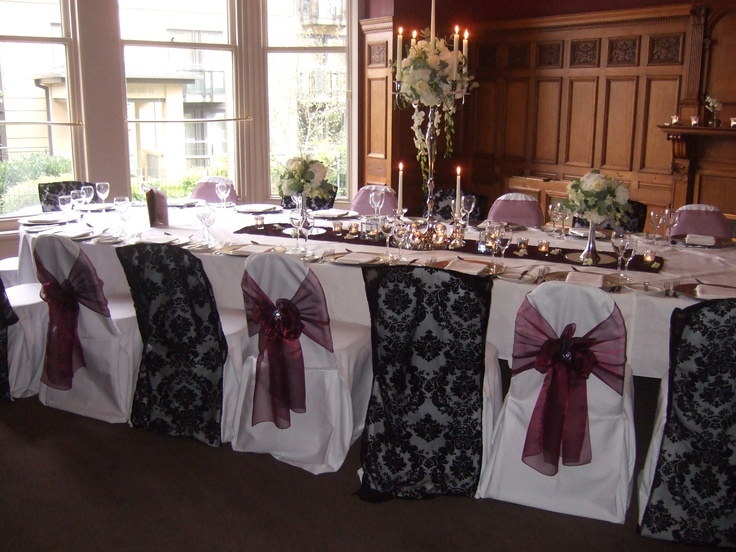 Black flocked organza chair veils and burgundy organza sashes on white chair Covers at the Crown Hotel Harrogate