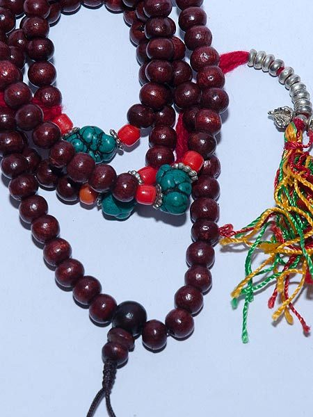8mm red wood mala with 108 beads and counters. The coral and turquise is not real but looks very authentic.