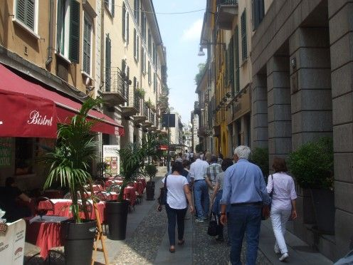 Tourists strolling through the charming streets of Brera in Milan.