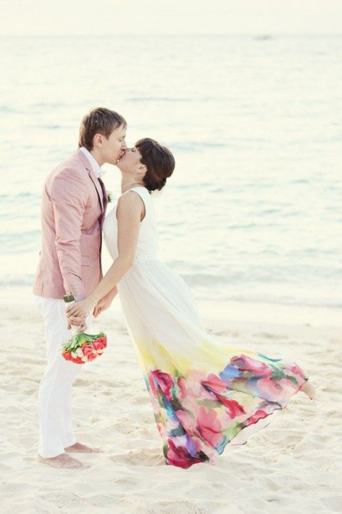 This bride and groom capture the mood of their beach wedding perfectly with their gorgeous outfits.