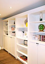 IKEA hack- billy bookcase (Really like the storage units on the bottom)  Basement family room