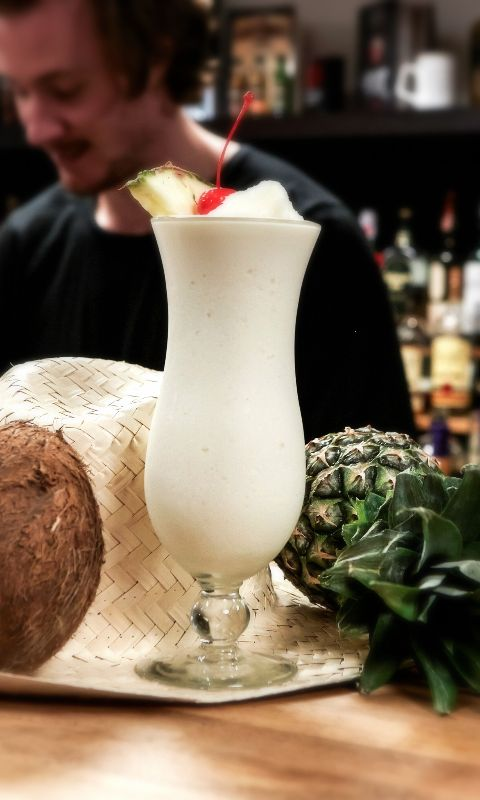Piña Colada Cocktail Recipe: 1 1/2 oz Light Rum 2 oz Pineapple Juice 3/4 oz Heavy Cream 3/4 oz Coconut Cream/ Milk 1 scoop Crushed Ice Glass: Hurricane Ice: Crushed Method: Blended Garnish: Pineapple wedge and cherry
