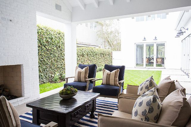 Oudoor Furniture and Fabric Ideas. Beautiful covered patio with outdoor fireplace, outdoor furniture covered in blue and white outdoor fabric. Blackband Design