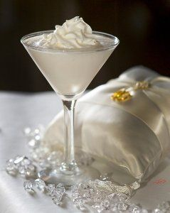Wedding Cake Martini 1.5 oz vanilla vodka 1/2 oz Malibu coconut rum 1.5 oz pineapple juice 1 splash grenadine syrup Blend ingredients together and top with whipped cream.