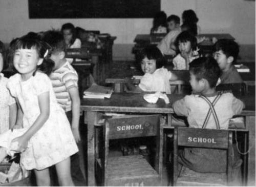 Children at school in a Japanese internment camp during World War II