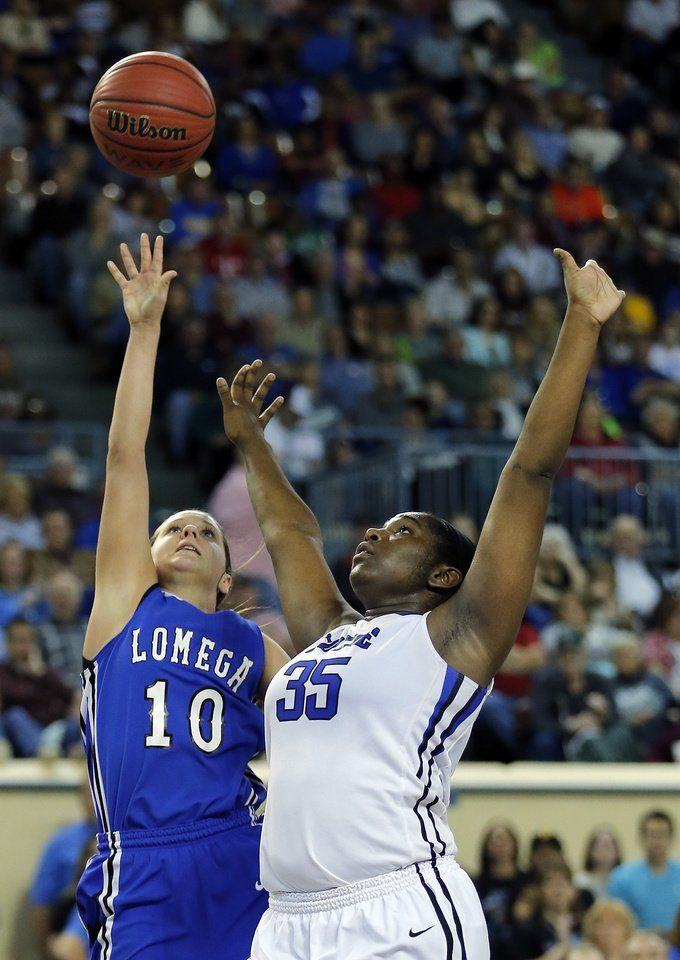 Logega's McKenzi Lamer shoots as Coyle's Shilah Young defends during the Class B girls high school basketball championship game between Lomega and Coyle at the Jim Norick Arena, aka The Big House, at State Fair Park in Oklahoma City, Saturday, March 7, 2015. Photo by Sarah Phipps, The Oklahoman