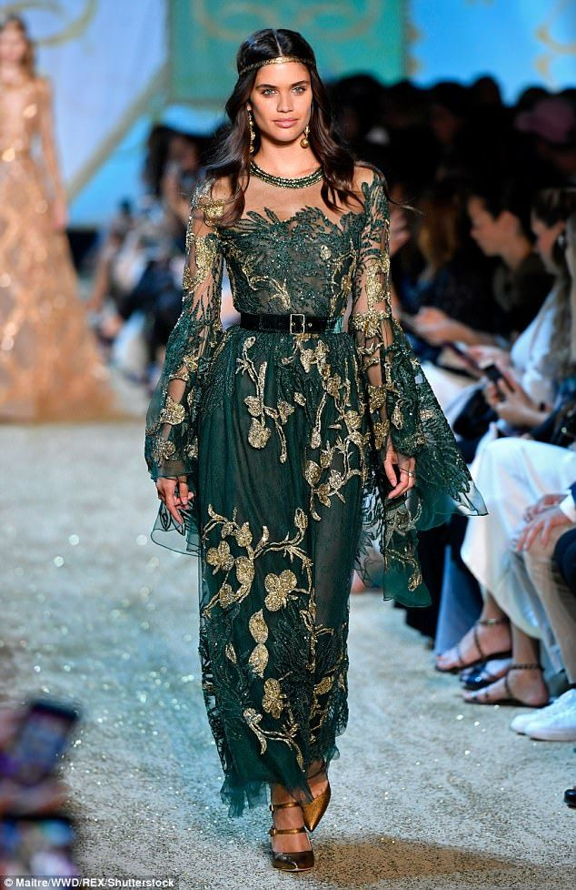 Turning green: Another stunning look saw the Portuguese beauty stepping out in an intricat...