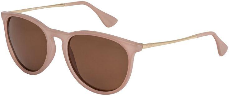 Incroyablement jolie lunette de la collection danoise Pilgrim comprenant une protection UV. Design d'avant-garde de couleur nude, branchons or rose et aux verres tan.   Le plus beau ? Pour 48$, elles sont polarisées !!