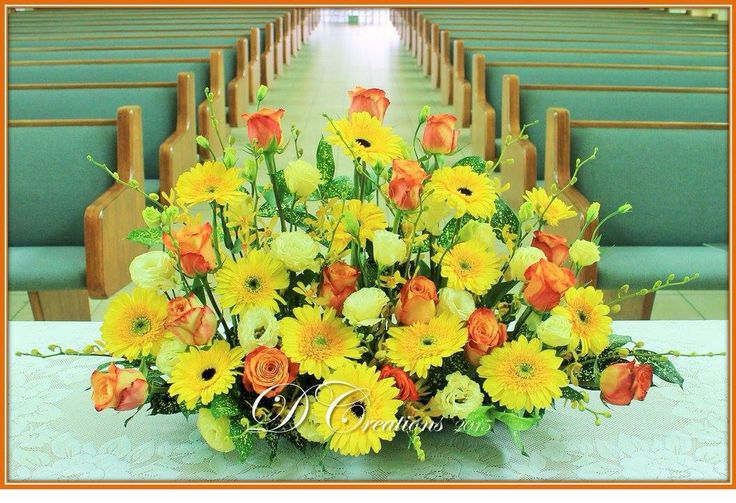 Bright cheery arrangement of yellow gerberas, two tone orange roses, eustomas and orchids