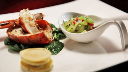 Red claw salad with coriander blini and lychee and kiwifruit salsa