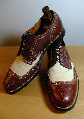 Item: one pair of extraordinary vintage spectator shoes by allen edmonds. They are primarily brick red pebble grain leather with a white vamp and tongue. They have an unusual wing tip that is rounded, rather than coming to a point, and a flour-de-li medallion. The insoles are stamped osteo-path-ic nailess construction. (Does not include shoe trees)condition: very good vintage conditionuppers are excellent. They have one or two insignificant scuffs but nothing noticeable. The biggest problem…