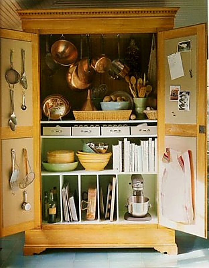 Turn an old Entertainment Centre into your very own ... >>  Bakers or Cooks Station !  Put EVERYTHING in this one area in organized shelves, baskets, slots , etc ..that suit your own needs.   ( LARGE PHOTO )