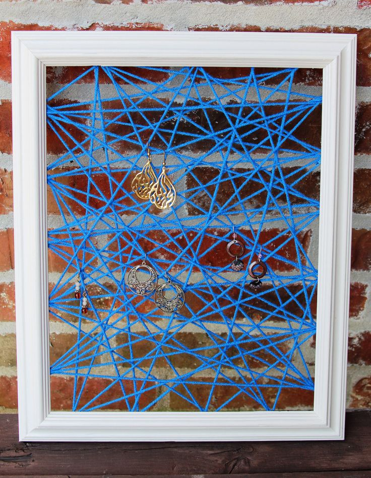 Jewelry Organizer/Display - Picture Frame earring holder - Cream with Blue Yarn - Jewelry Frame. $22.00, via Etsy.