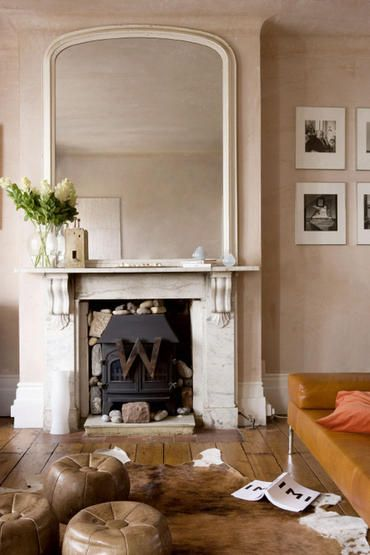 Fire Place And Huge Mirror