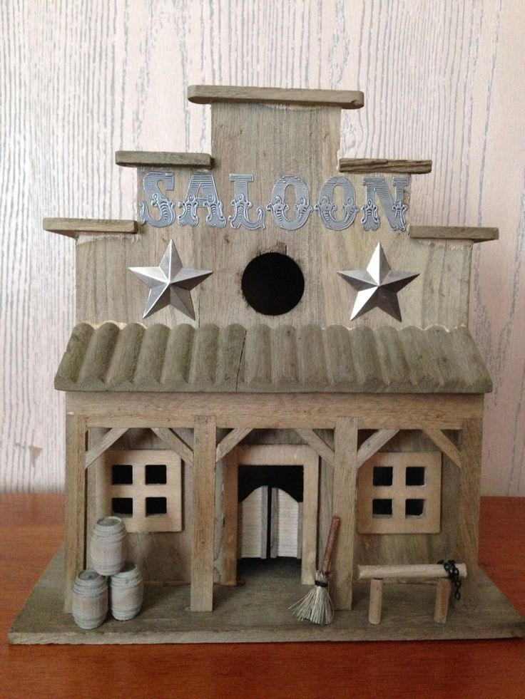 Rustic and primitive saloon birdhouse.