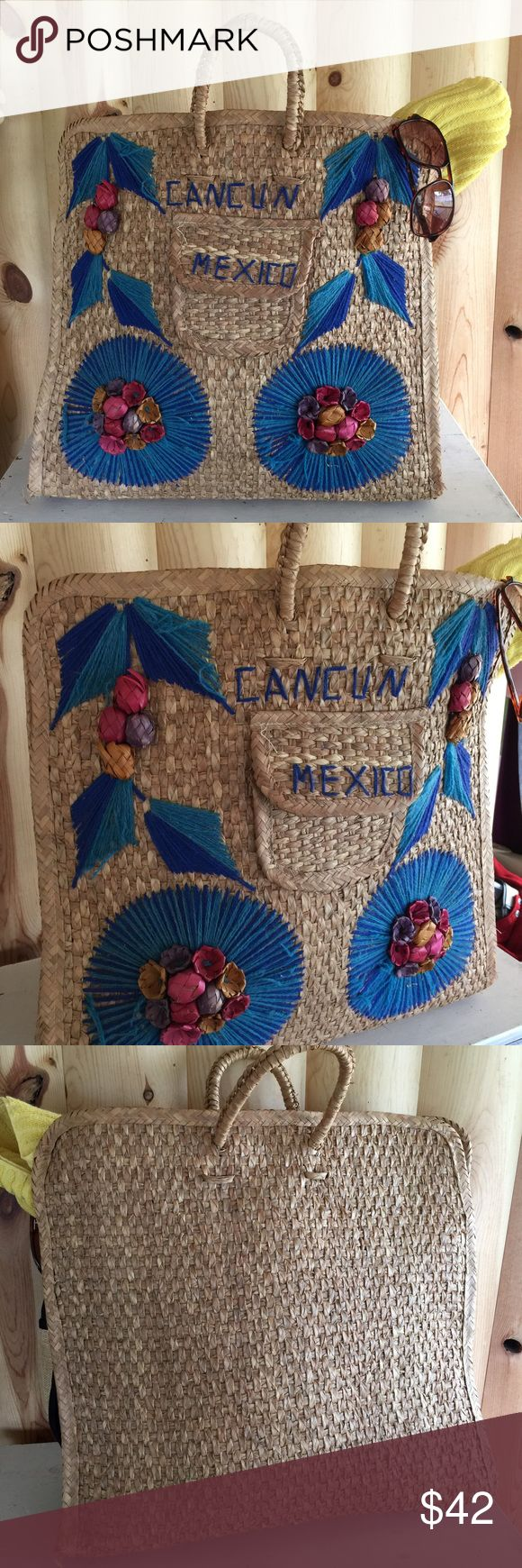 "HP! Vtg MEXICO woven straw beach bag/tote bag Host pick 7.8 / Best in Swim Party ⛱! Festival-ready 1970s tourist Cancun Mexico souvenir large tote bag. Use for the beach, pool, or anywhere you want to make a statement! Normal wear & gentle fraying from usage- adds to the boho/festival look! See bottom corner photo, both sides look similar. 23"" by 20"" , (including handles) will arrive in a large box Vintage Swim"