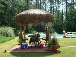 tiki hut made out of a old satllite dish   Tiki Hut Pavillion made from a satellite dish :) What an awesome idea.