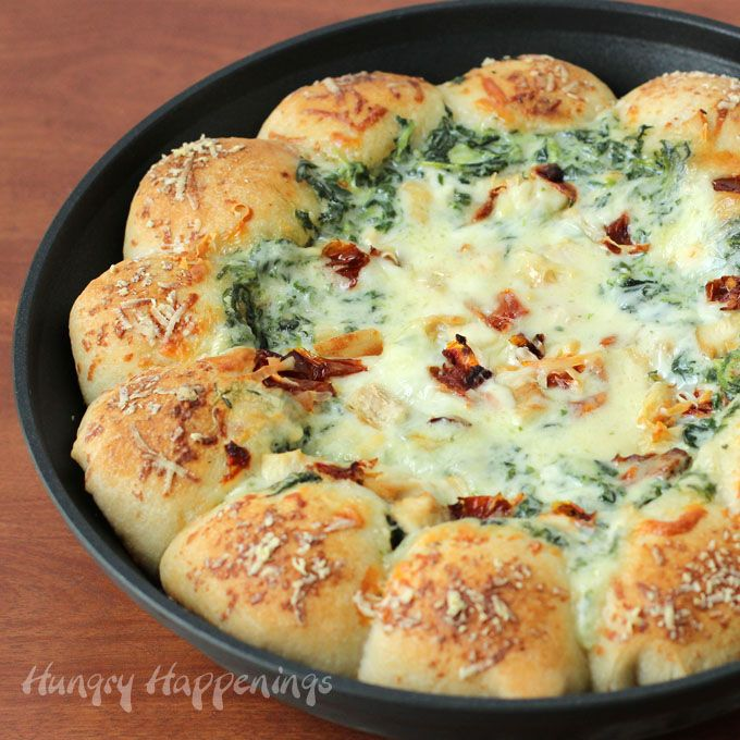Break off a piece of mozzarella cheese filled pizza crust and scoop up some cream spinach alfredo dip and enjoy bits of chicken and bacon in every bite.