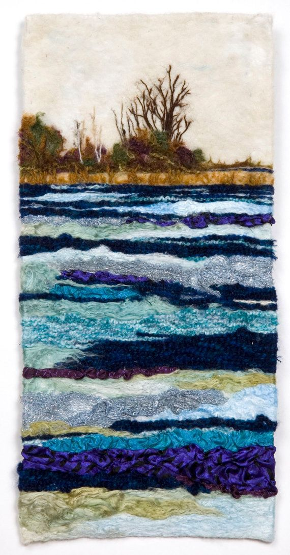 PRECIOUS COMMODITY is a flowing and elegant fiber art wall hanging made of felt and fabric