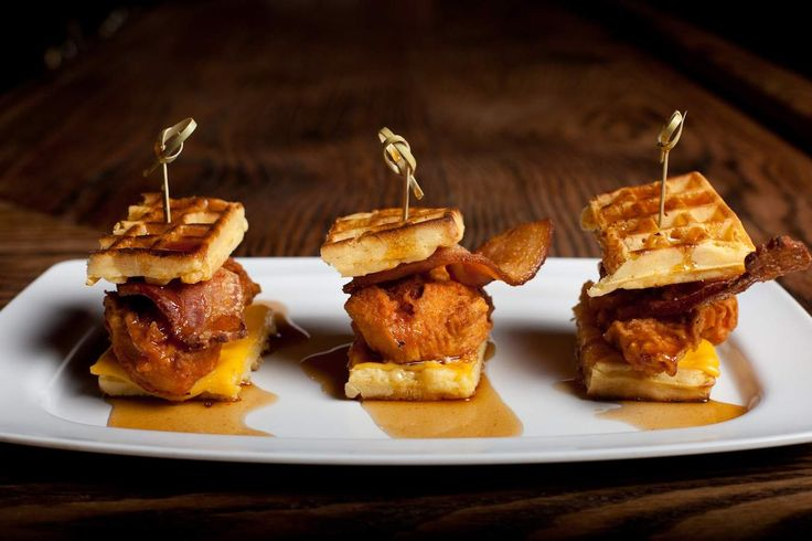 Chicken and Waffle Sliders - Served at Brooklyn's Pork Slope, these mini versions of your beloved chicken and waffles come with their own spicy maple syrup. And also bacon and cheese, because that chef is no dummy.(from10 wild waffles to celebrate National Waffle Day)