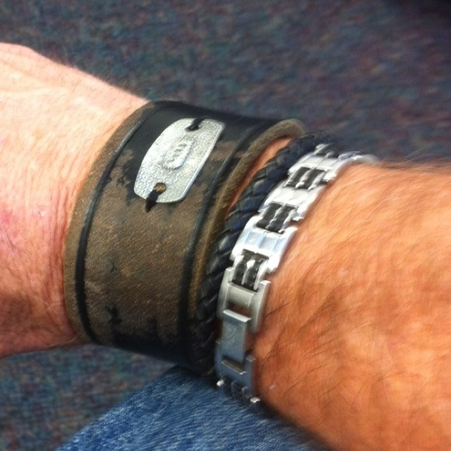 Boss happy customer boss tag sewn onto leather cuff Repurposed leather belts
