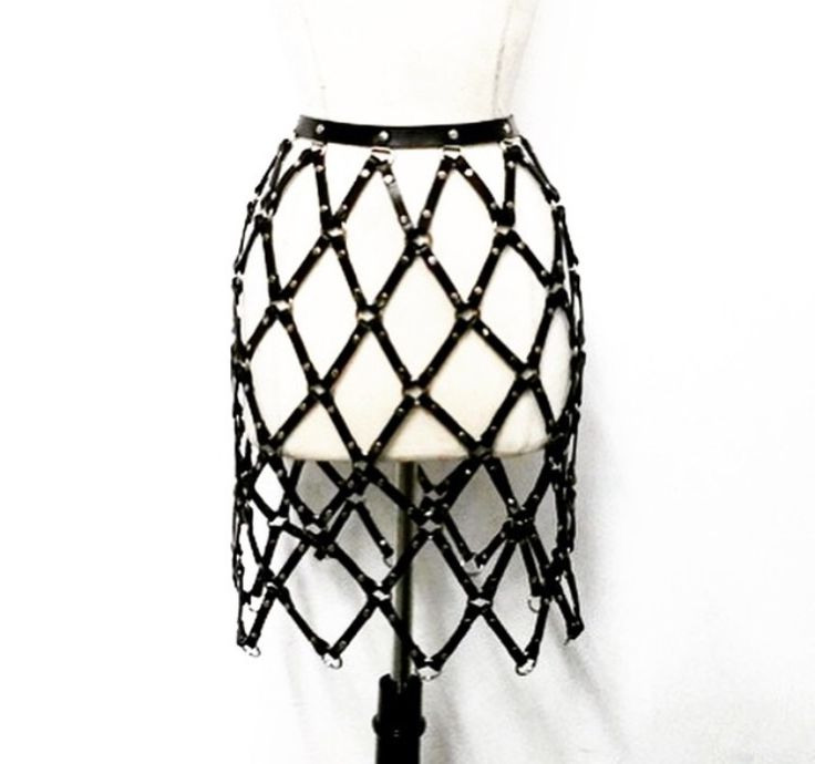 #Manokhi black leather skirt with silver or gold accesories (your choice)