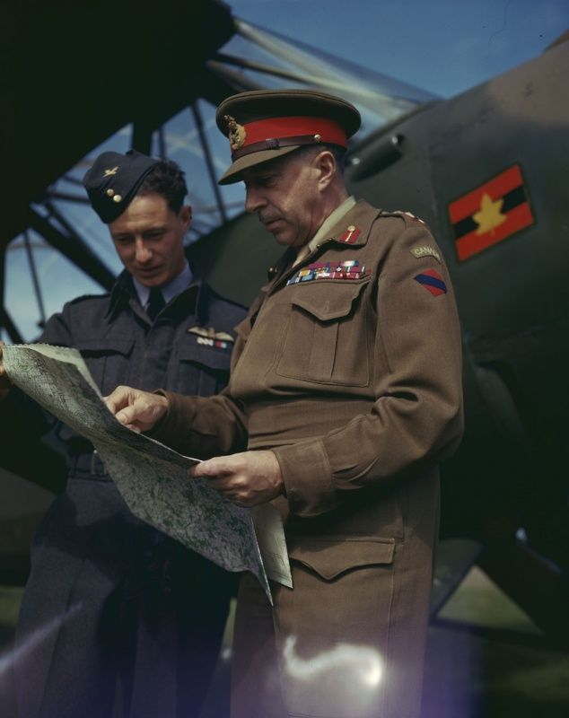 Canadian Lieutenant General Henry Crerar, (1888-1965) and pilot Lt. James Smith at the plane.