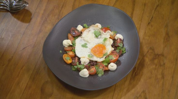 Fried egg, black bean and tomato salad, and goats cheese cream