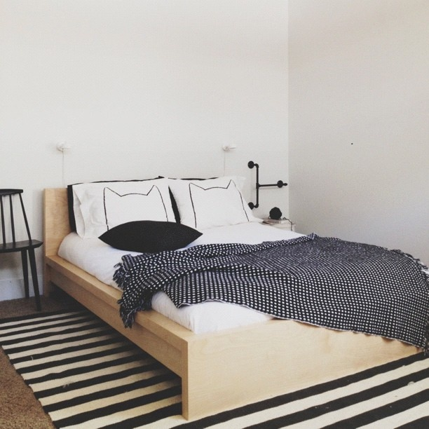 Ralphie's room. Malm bed in this finish with black and white striped rug from…