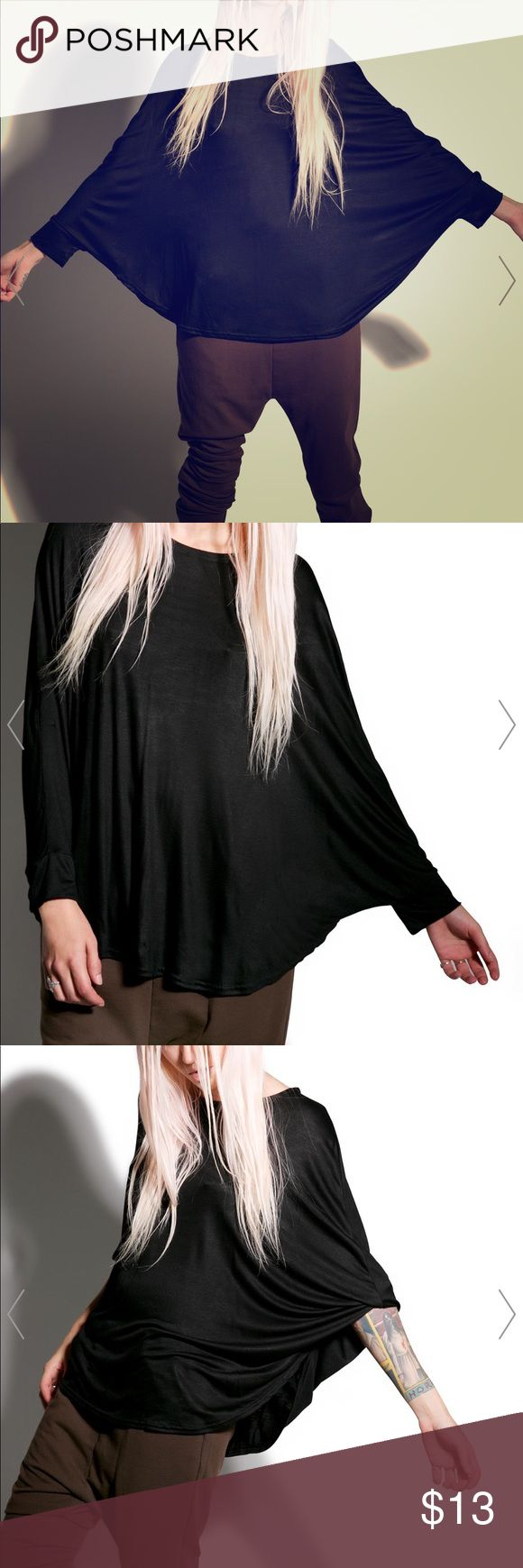 BLACK BATWING TOP DOLLS KILL Can't tell me nothin' batwing top is made of a Polyester blend with sikk long batwing sleeves, side slits, and a crazy drape that won't let anyone give a chance to even say somethin' Dolls Kill Tops Tees - Long Sleeve