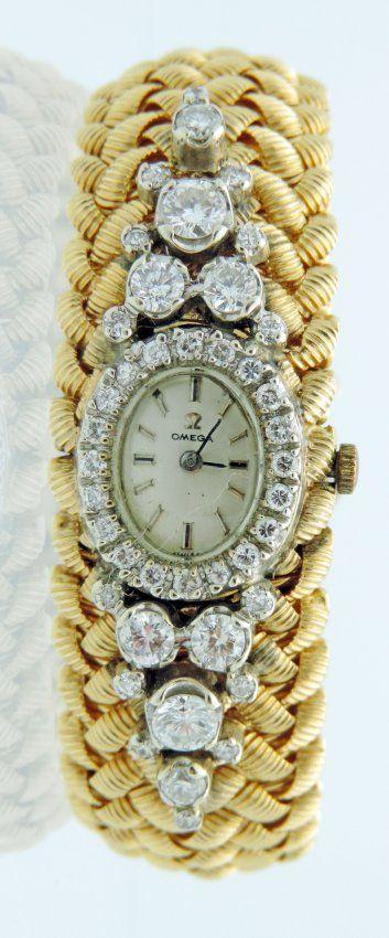2.75 CT Diamond and 18K Omega Ladies Watch.  Diamond
