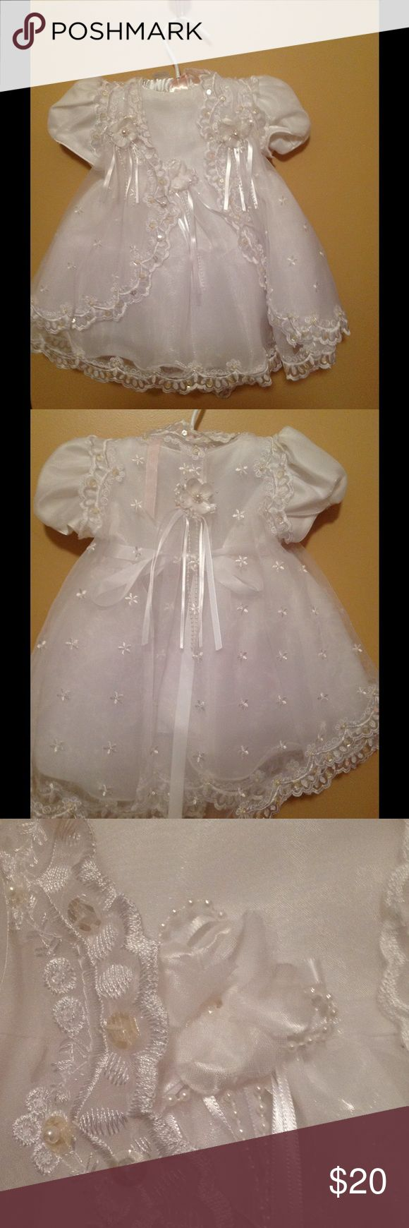 Communion/Formal dress Used for two hours and still beautiful with pearl accents and gorgeous lace detailing. It is missing a tiny pearl accent in middle of a flower but that can be easily replaced. It comes with a cute satin bonnet. The dress has a little tulle material for added volume. Dresses Formal
