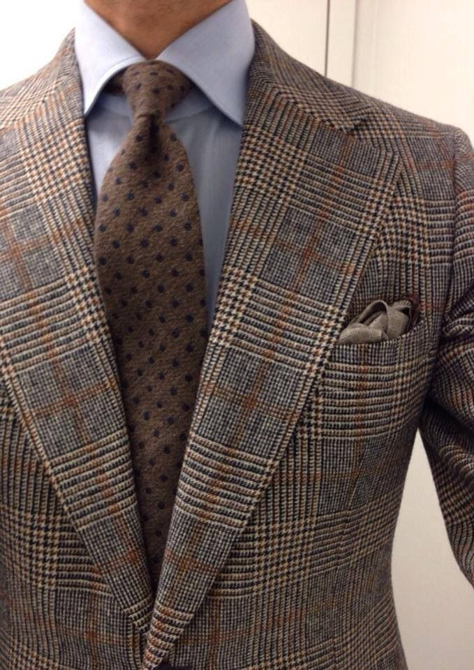Huge lapels, but I like the colors, pattern, and textures in the jacket and tie