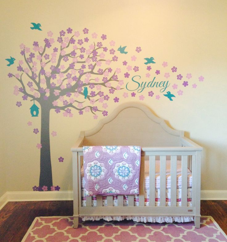 My purple & teal nursery is 1/2 way complete. I love my custom tree by Surface Inspired. *Crib- Bassett  *Rug- Target *Bedding- Pottery Barn