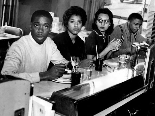 Matthew Walker, from left, Peggy Alexander, Diane Nash and Stanley Hemphill, eat lunch at the previously segregated counter of the Post House Restaurant in the Greyhound bus terminal in Nashville, Tenn. on May 16, 1960. This marked the first time since the start of the sit-in that blacks have been served at previously all-white counters in Nashville.(Photo: Gerald Holly, The Tennessean)