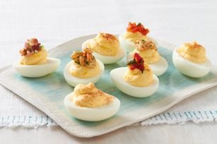 BEST DEVILED EGG RECIPE ON THE PLANET! I've always made mine like this (minus a garnish on top) and people rave over them! SOOO good!