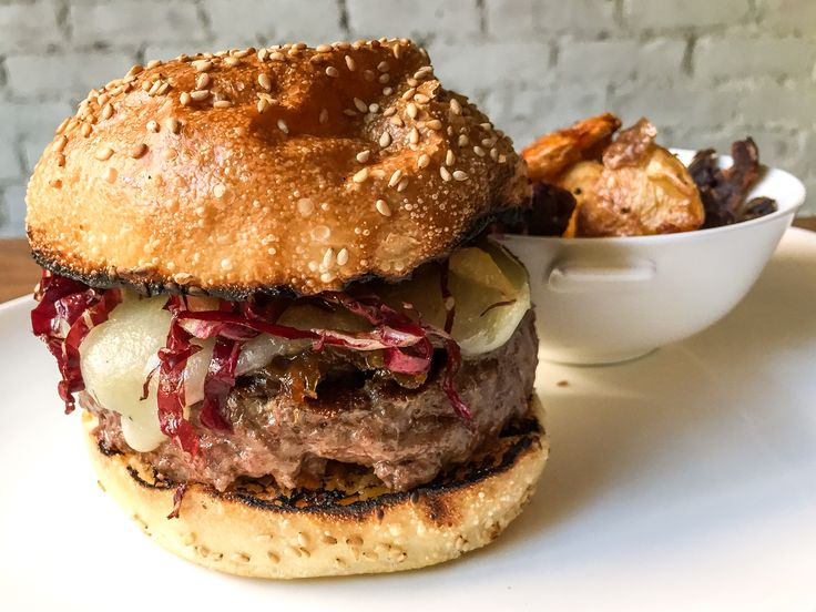 All'onda #Burger ($17):  Made From Ground Short Rib,  Topped With Truffled Sottocenere Cheese, Shredded Treviso, Caramelized Onions, and Comes With A Side Of Parmesan Potatoes.  - Eater NY