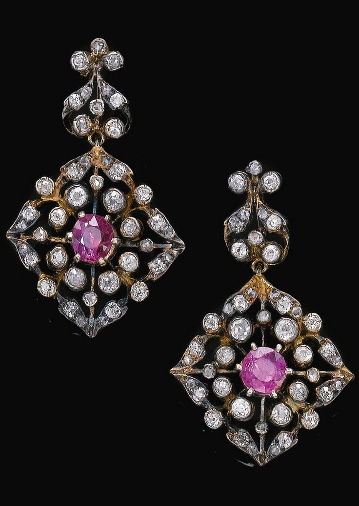 A pair of antique diamond and ruby earrings, 19th century. Set with circular-cut and cushion-shaped rubies, circular-cut and rose diamonds, screw back fittings. #antique #earrings