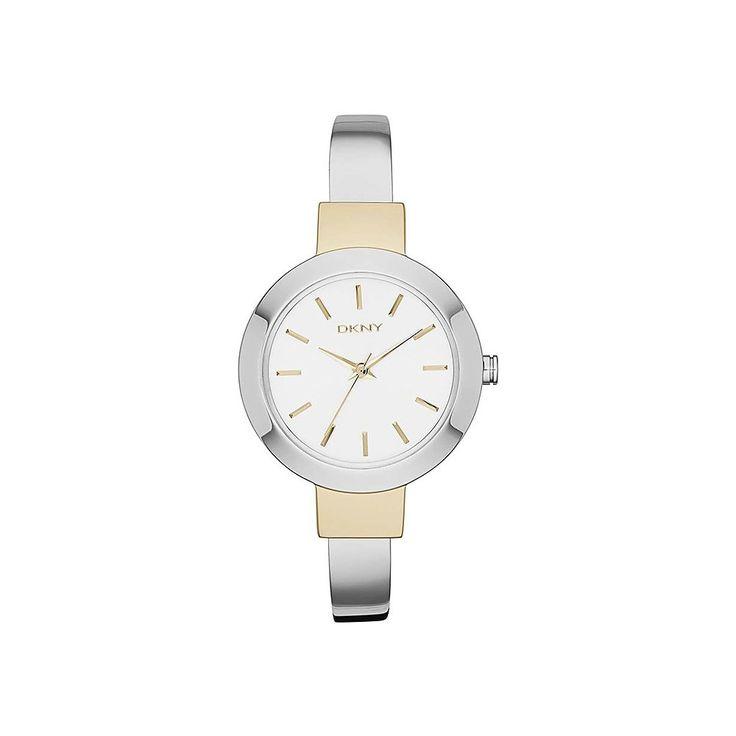 DKNY Stanhope DKNY2352 to damski zegarek zaprojektowany dla kobiet lubiących subtelne i proste dodatki. Ten nieduży czasomierz idealnie pasuje do damskiego nadgarstka. W delikatnej stalowej kopercie o średnicy 28 mm i grubości 9 mm ujęto biały cyferblat wykończony złotymi indeksami. Kopertę w ciekawy sposób zestawiono z nieregulowaną bransoletą.  #zegarek #zegarki #dkny #timetrend