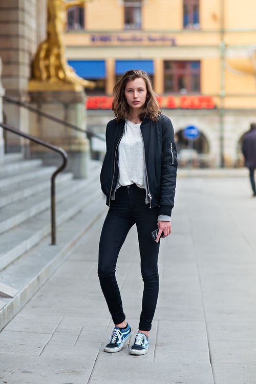 Shop this look for $81:  http://lookastic.com/women/looks/navy-bomber-jacket-and-white-crew-neck-t-shirt-and-black-skinny-jeans-and-navy-low-top-sneakers/2563  — Navy Bomber Jacket  — White Crew-neck T-shirt  — Black Skinny Jeans  — Navy Low Top Sneakers