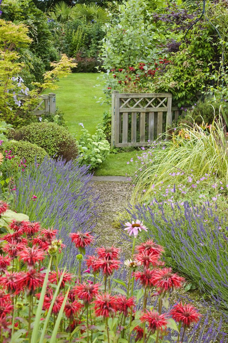 Use gravel to pave a garden path that meanders alongside your flower beds. The key is to avoid any rigid lines, instead letting the path wind to mimic the free-flowing nature of the flowers beside it.   - CountryLiving.com