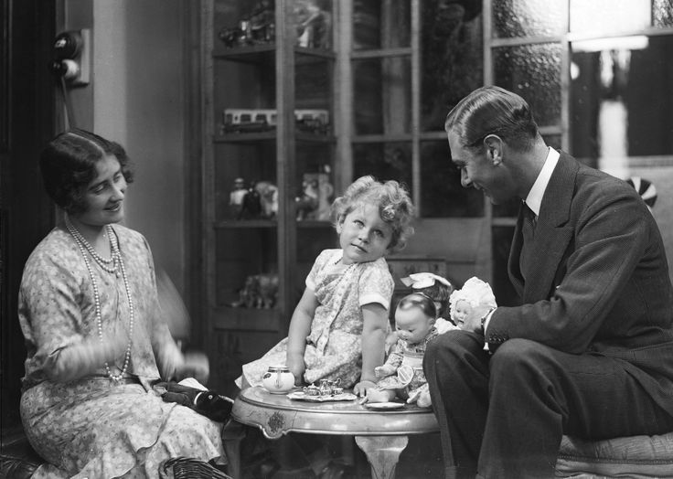 King George and Queen Elizabeth and Princess Elizabeth.  Doll's tea party. 1929