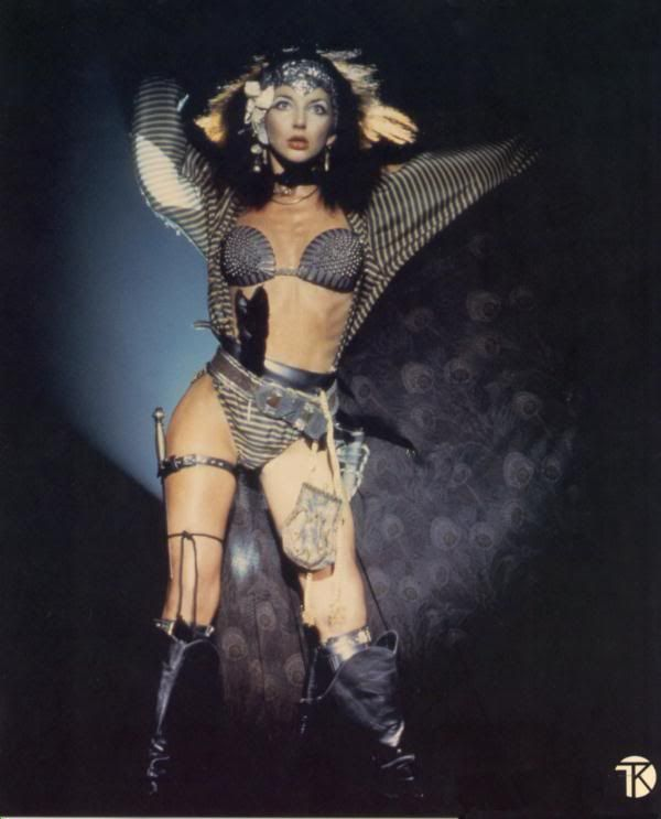 """Let's Bring Back: Chainmail Bikinis.  Probably made most fashionable by Kate Bush in her Babooshka music video. There's something very old world and mythical about them.  Even if we don't all have the bodies for them, as demonstrated when I searched """"chainmail bikini"""" under Google images.  It's at least a good New Year's goal."""
