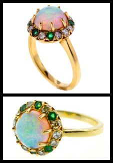 Victorian emerald, diamond, and opal ring in gold. Via Diamonds in the Library.