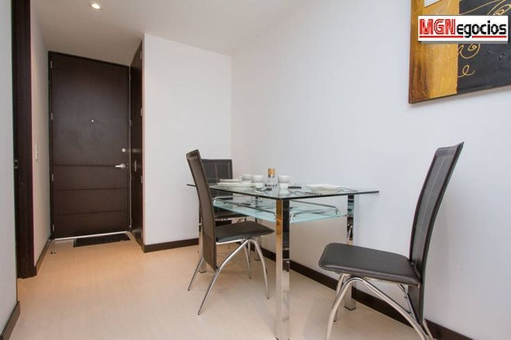 Dining room with a 4 person modern dining table.