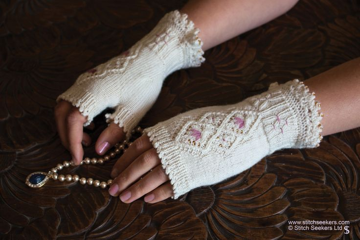 Miss Havisham -  Combine simple lace knitting, beads, picot bind off and basic embroidery, to create these delicate mitts.  www.stitchseekers.com #editionone