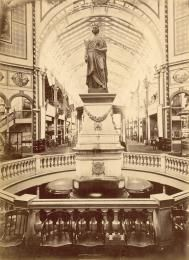 Photographic print, mounted in album, interior view, statue of Queen Victoria in the 1879 Sydney Exhibition 'Garden Palace' building, paper / albumen / silver, photographed by Messrs Richards and Company for the International Exhibition Commissi - Powerhouse Museum Collection