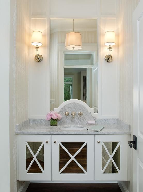 Glam Powder Room Boasts A Floating Vanity Fitted With