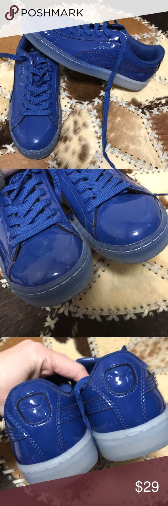 Puma blue sneakers NWOT Pretty shiny blue! Never worn. Has a couple of teensy vague spots I show in pic. Soles have a cool ombré effect. No box. Snag a deal! Bundling is fun; check out my other items & save!  Home is smoke free/ cat friendly. No price talk in comments. No trades or holds. Puma Shoes Sneakers